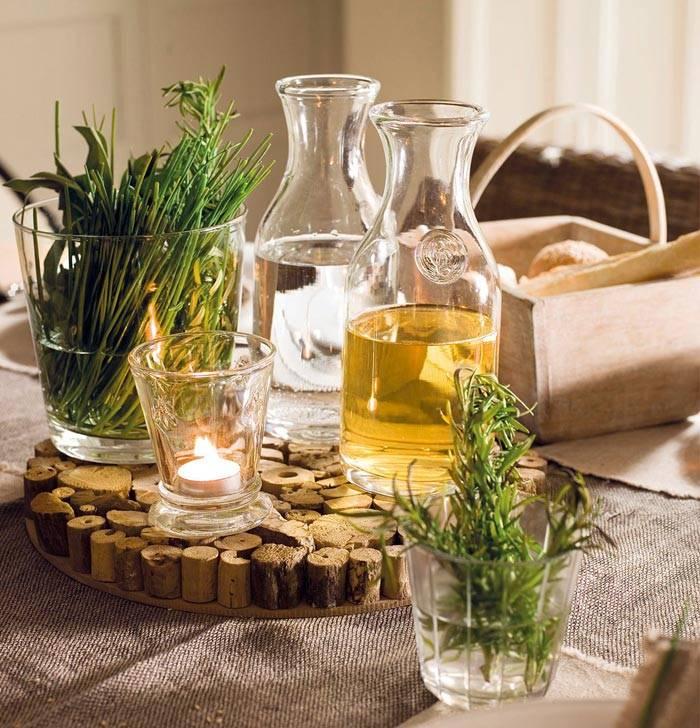 красивые бутылочки с маслами и травами в декоре кухни фото