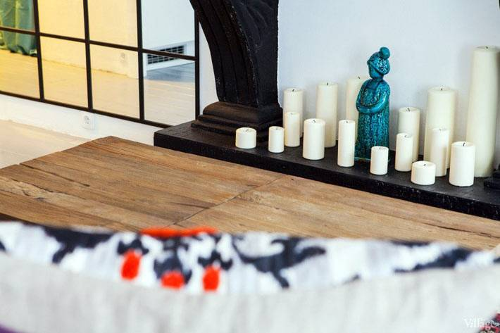 свечной камин в интрьере гостиной
