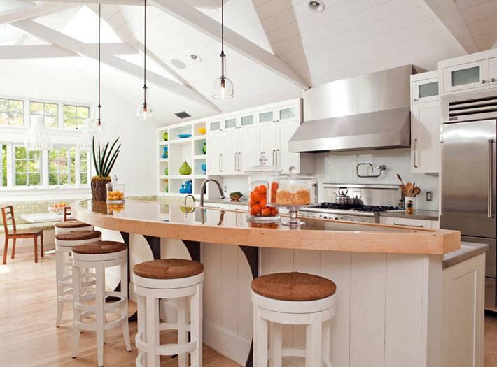 красивый дизайн интерьера кухни с барной стойкой