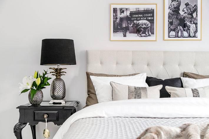 красивая лампа на прикроватном столике в интерьере спальни