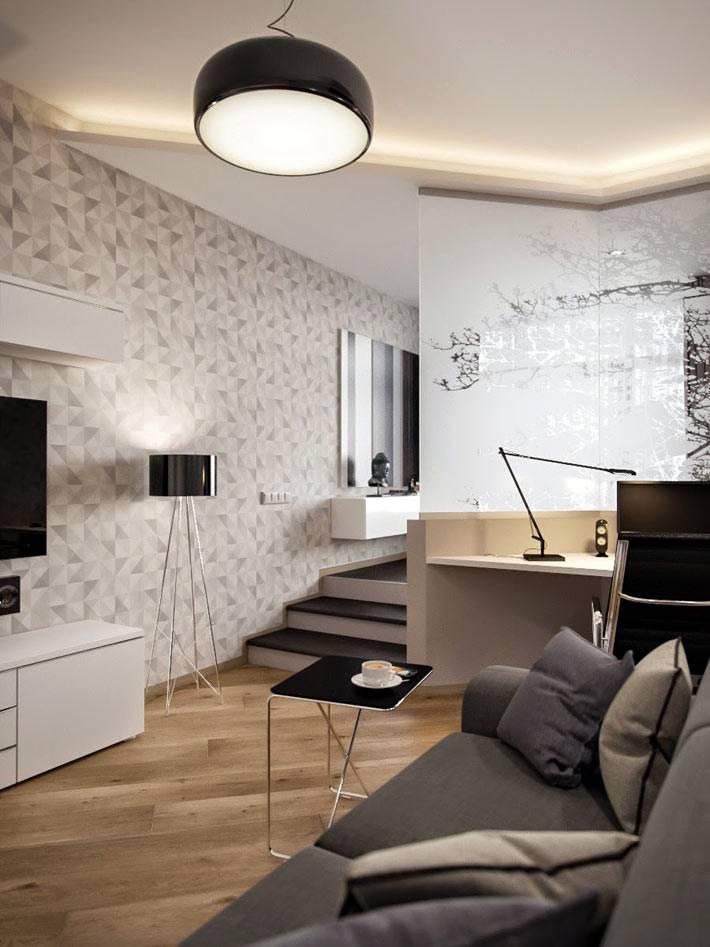 рабочее место, спальня и гостиная в одной комнате