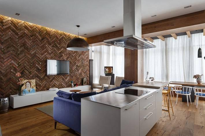 квартира-студия, где гостиная совмещенная с кухней и столовой фото
