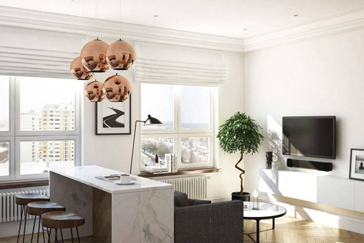 Квартира студия с белыми стенами для зрительного увеличения пространства фото