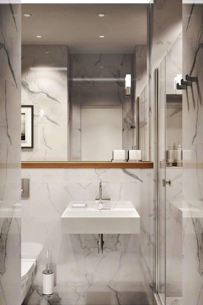 Мраморная плитка в дизайне интерьера ванной комнаты фото