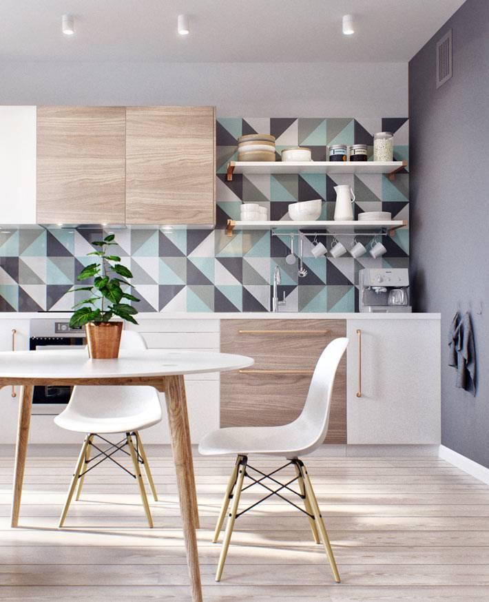 Модная плитка с рисунком из треугольников для рабочей зоны кухни фото