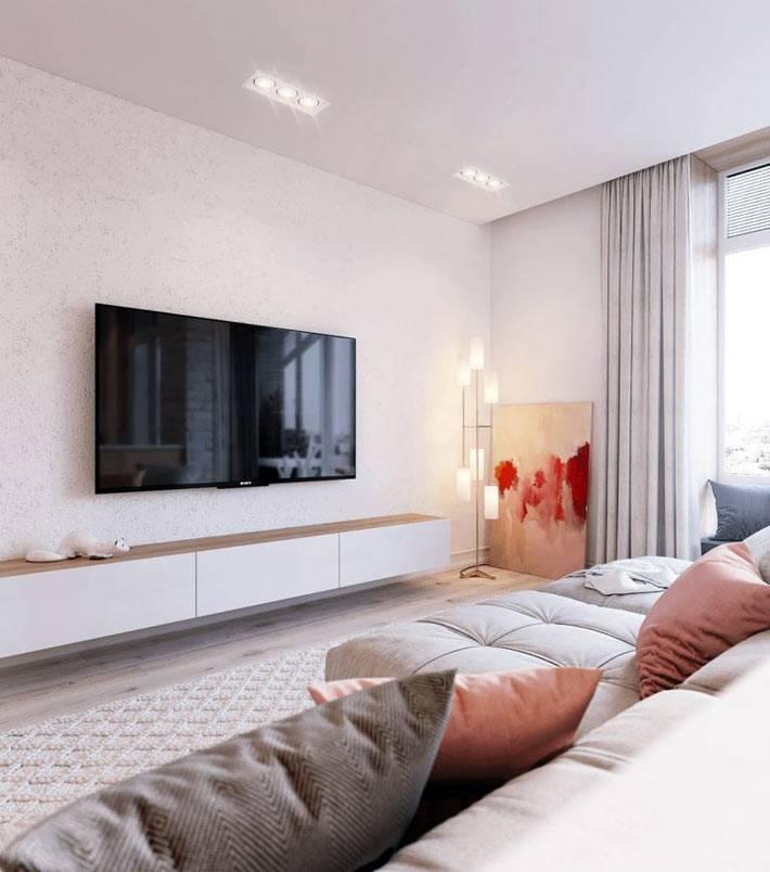 Подвесные шкафчики под телевизором в гостиной комнате
