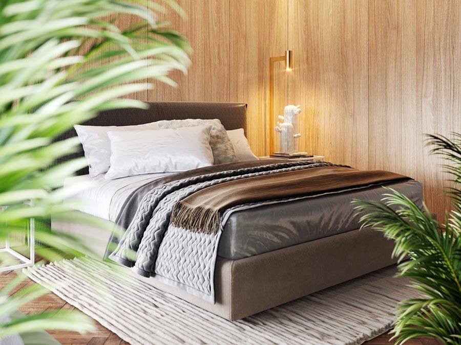 интерьер спальни с деревянными стенами и большой кроватью