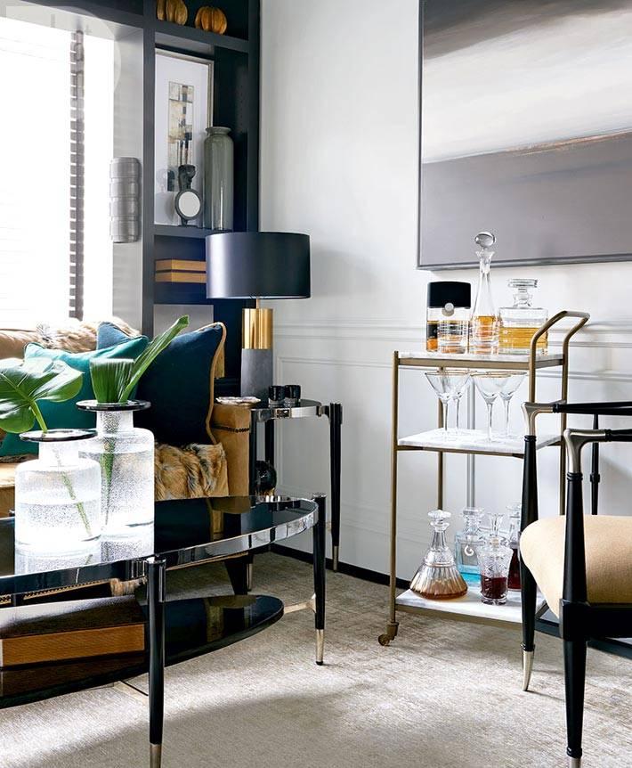 элегантный овальный черный журнальный столик фото