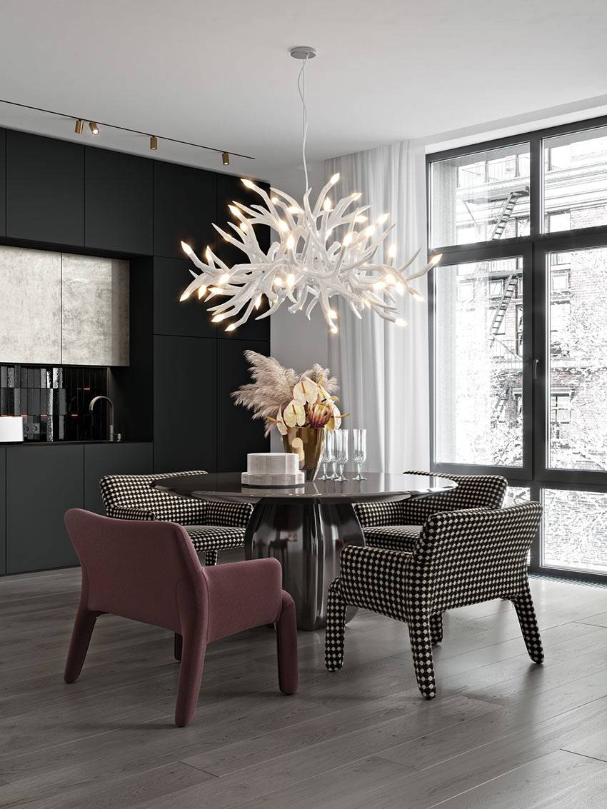просторная кухня с черной мебелью и белой люстрой