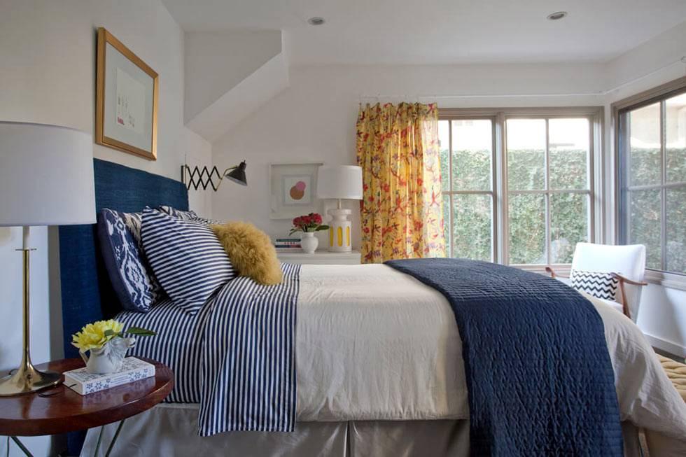 дизайн интерьера спальни с угловым окном и красивым видом