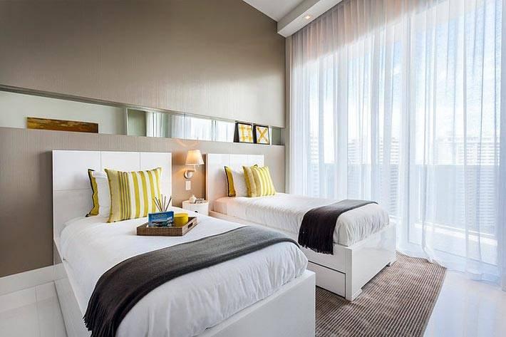стильный стерильный интерьер комнаты для двоих детей