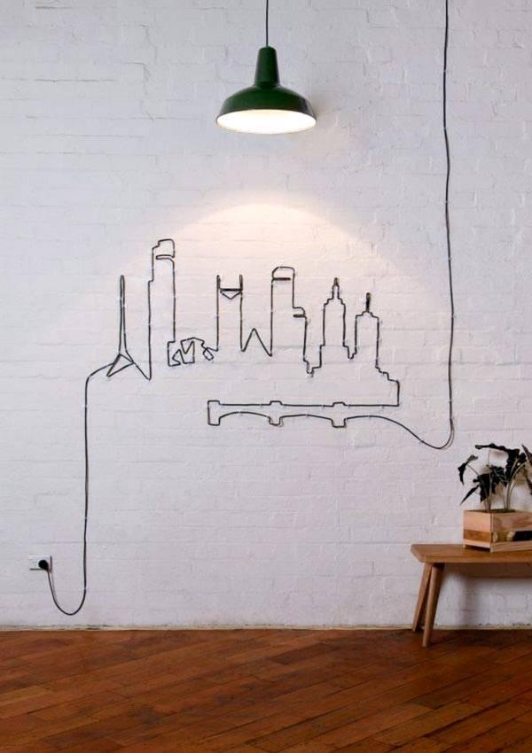 Рисунок на стене из черного кабельного провода фото