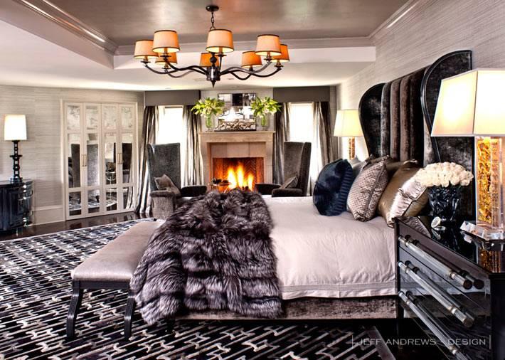зимний интерьер спальни с меховым одеялом и камином