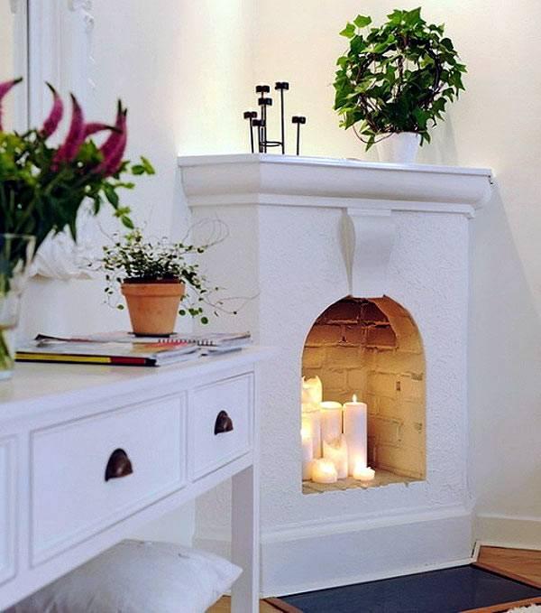 Камин в квартире со свечами фото