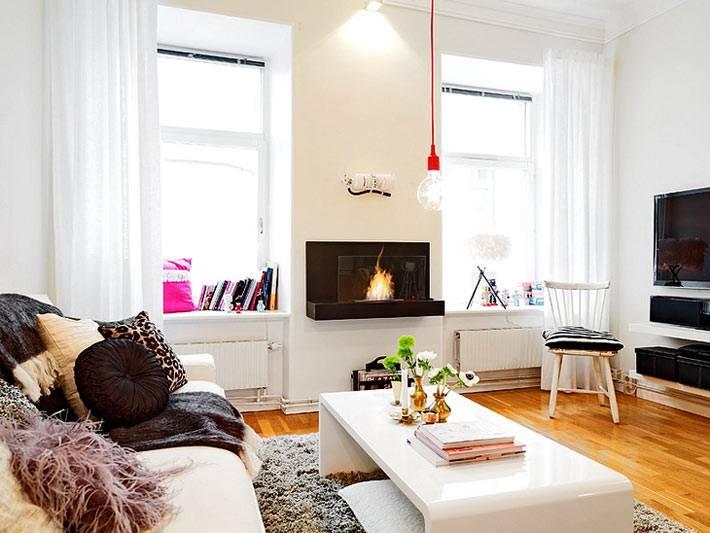 Электрический камин в дизайне гостиной квартиры