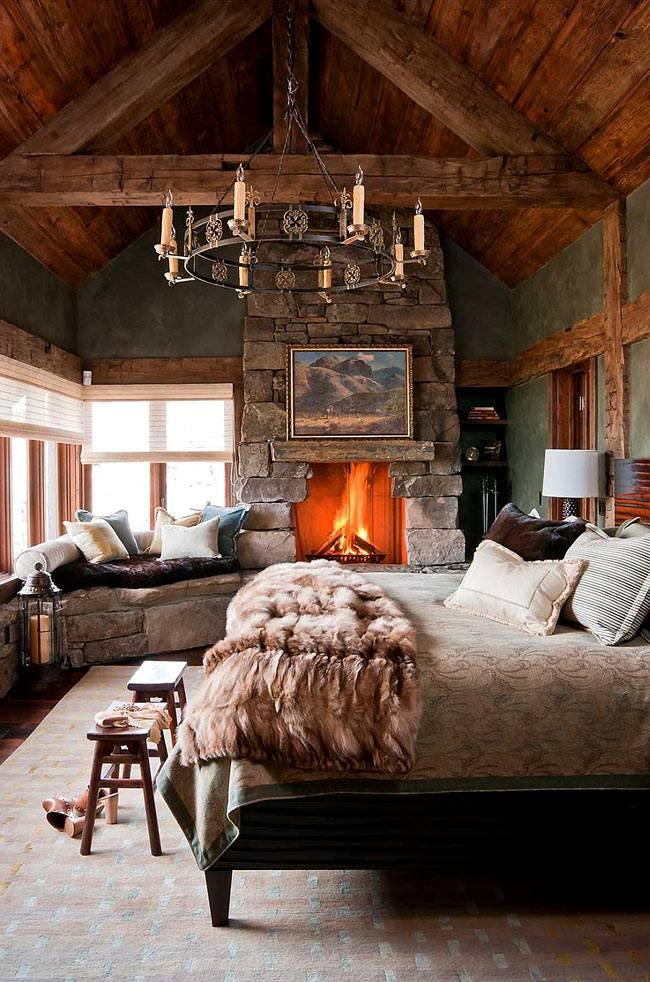зимний интерьер спальни с камином и мягким подоконником