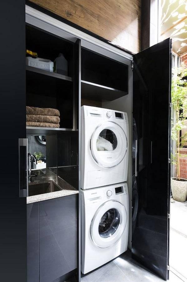 стиральная машина и сушилка в черном шкафу фото