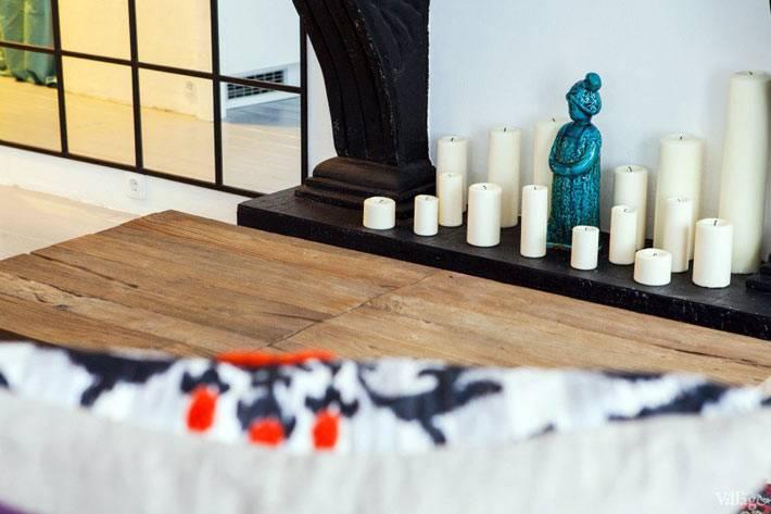 свечной декоративный камин в интрьере гостиной