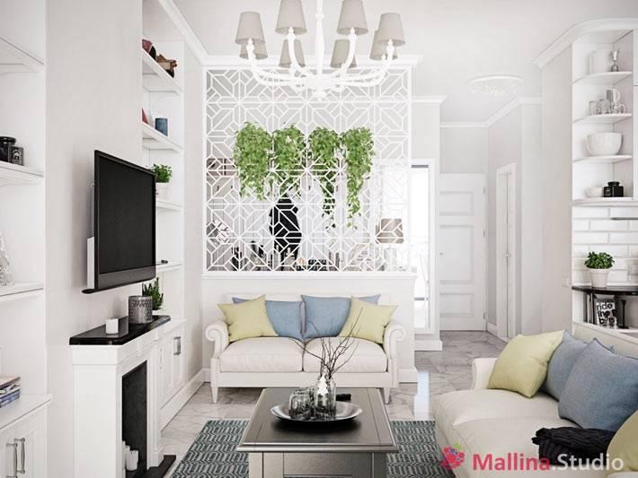 белая ажурная перегородка в интерьере гостиной комнаты