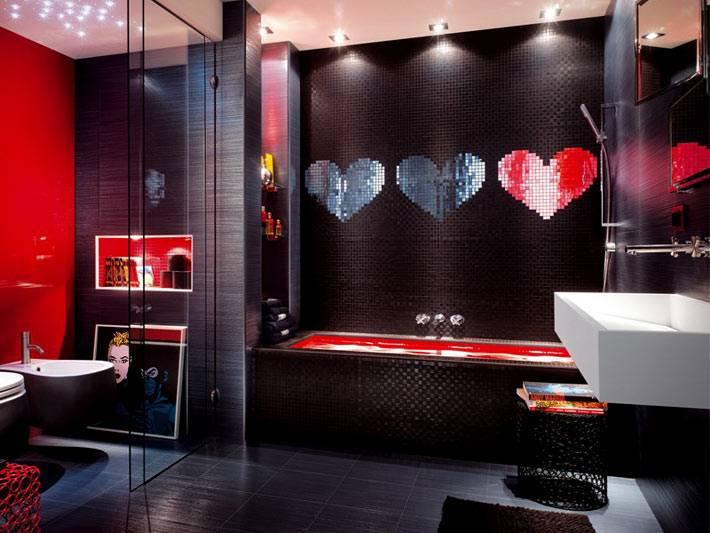 яркие элементы на фоне черных стен в стильной ванной комнате