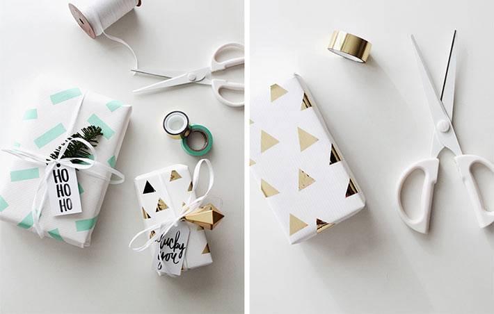 золотистые детали в новогодней упаковке подарков