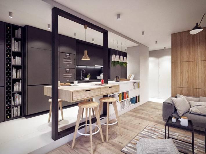 небольшая кухня с черной мебелью на белом подиуме
