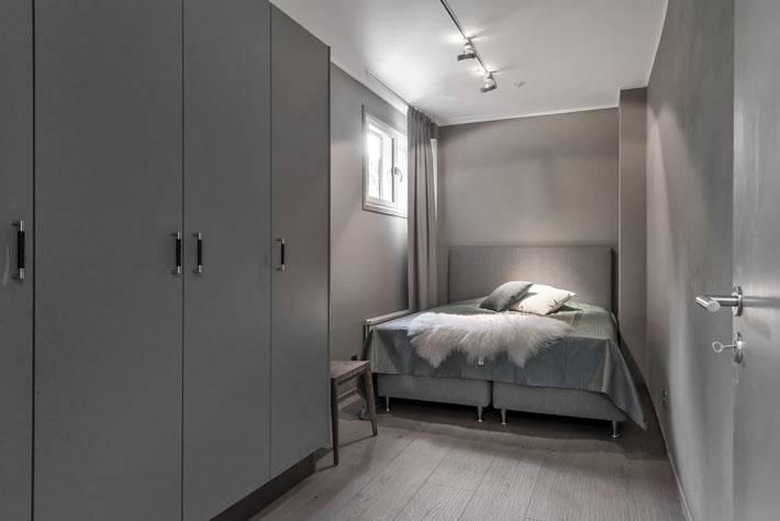 Монохромный интерьер спальни серого цвета фото