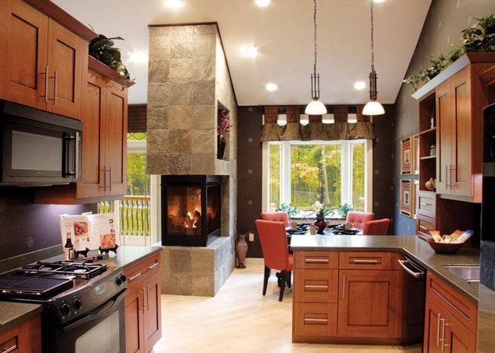 Встроенный камин в каменной стене на кухне фото