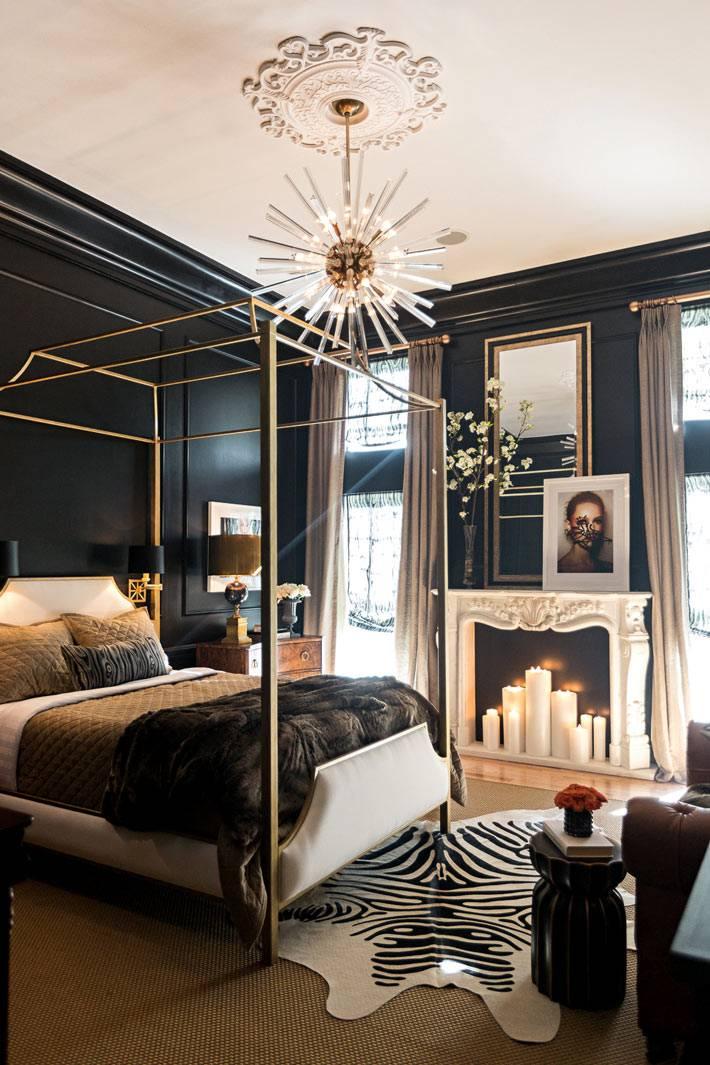 Роскошная спальня с фальш-камином и свечами фото