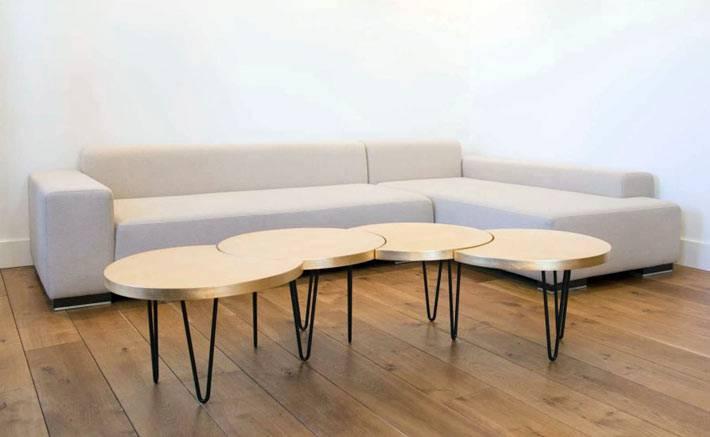 один цельный стол из пяти круглых элементов фото