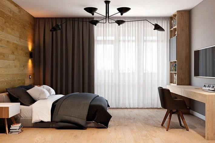 мужская спальная комната с рабочим столом и телевизором