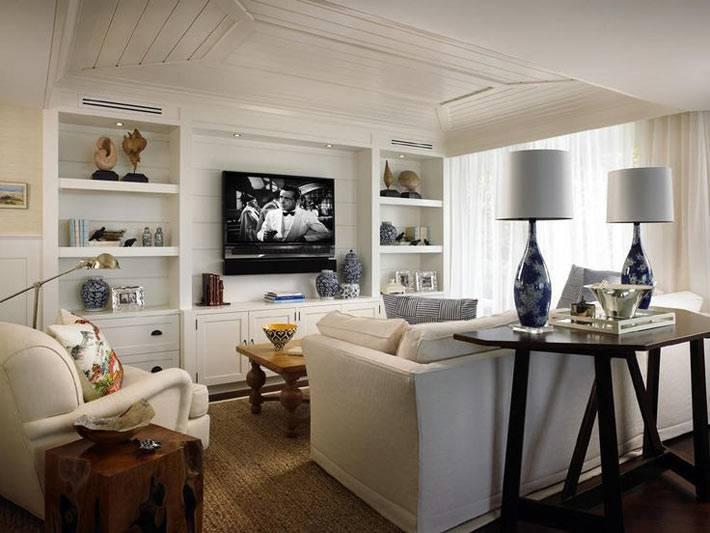 уютная белая комната, оббитая деревом фото