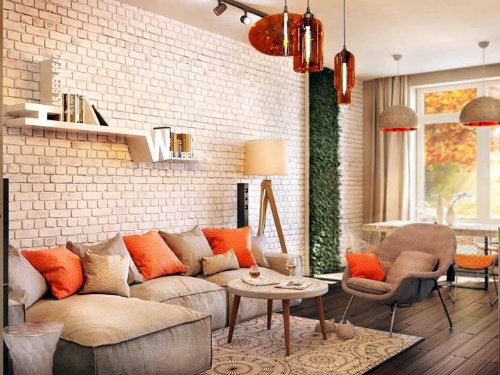 бежево-серые оттенки разбавлны яркими оранжевыми подушками