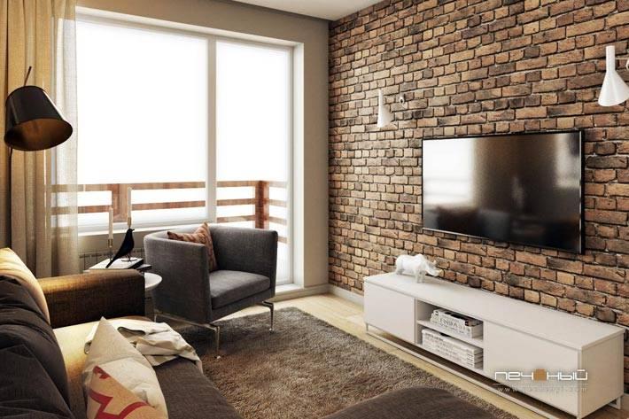 телевизор на кирпичной стене в интерьере гостиной комнаты
