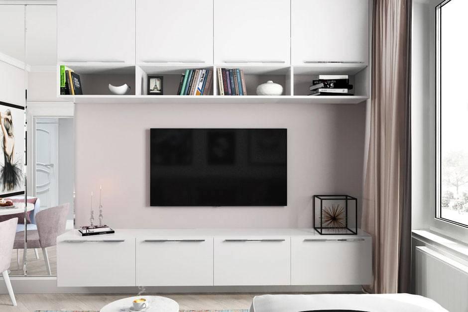большой плоский телевизор на стене гостиной комнаты