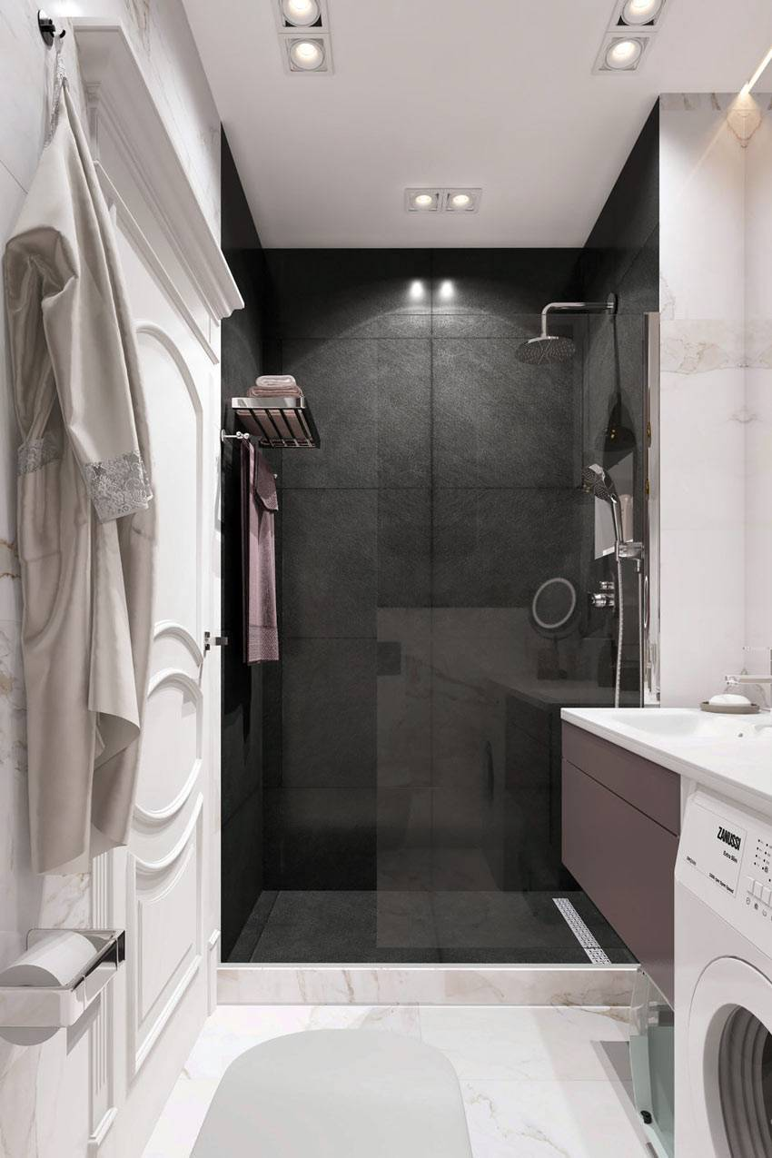 черная плитка в душевой кабине в белой ванной комнате