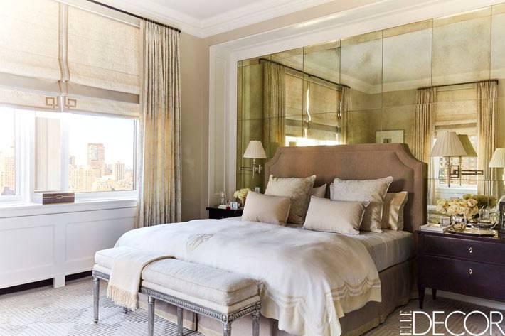 зеркальная стена за изголовьем кровати в спальне