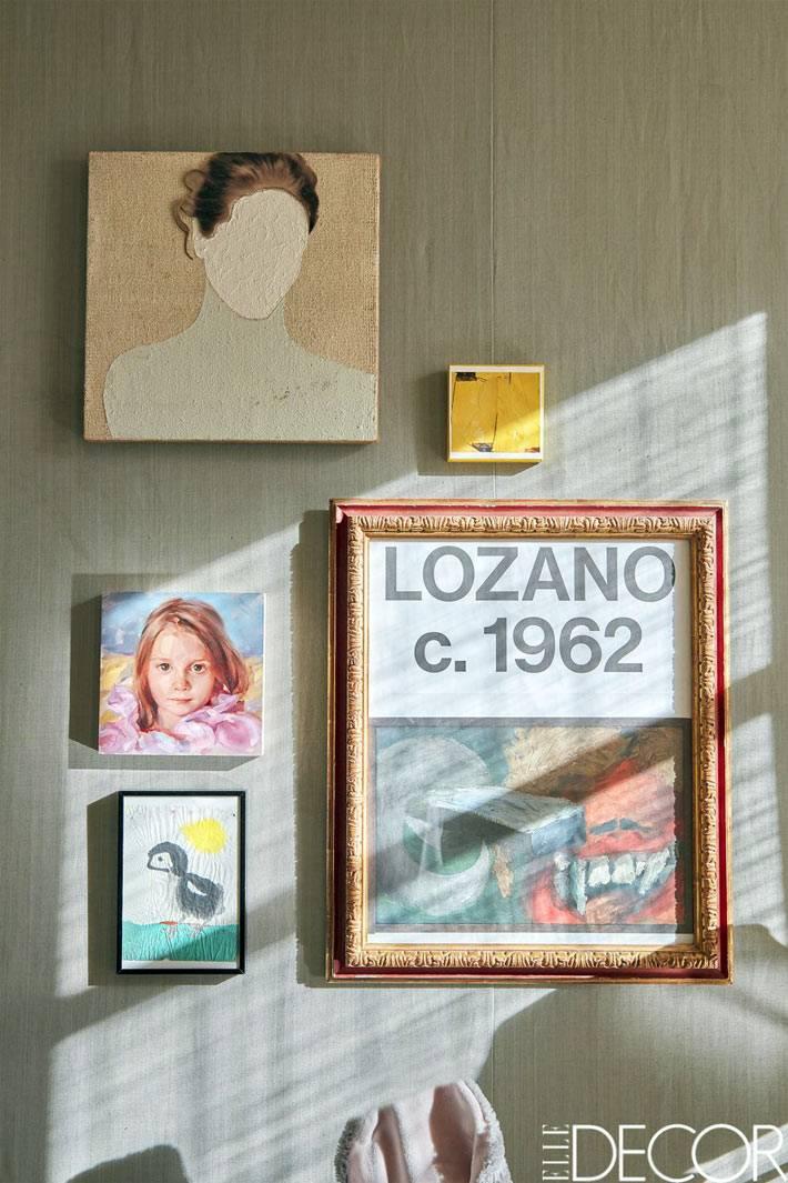 стены детской украшены картинами и рисунками в рамках