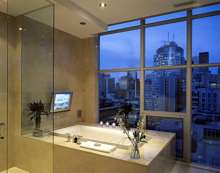 современный дизайн ванной со стеклянной стеной фото