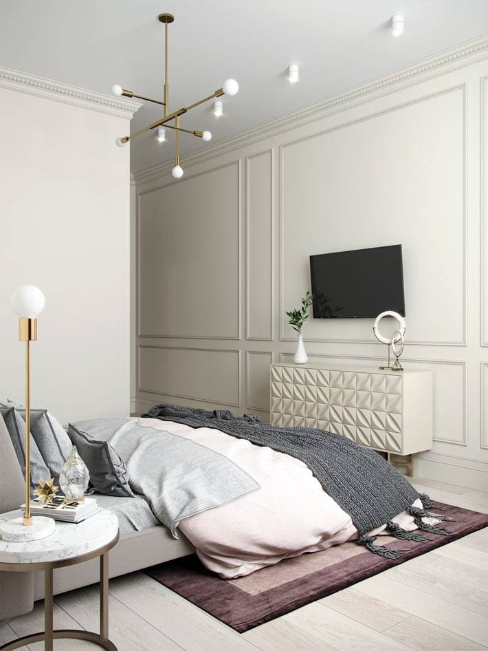 телевизор и комод напротив кровати в спальне фото