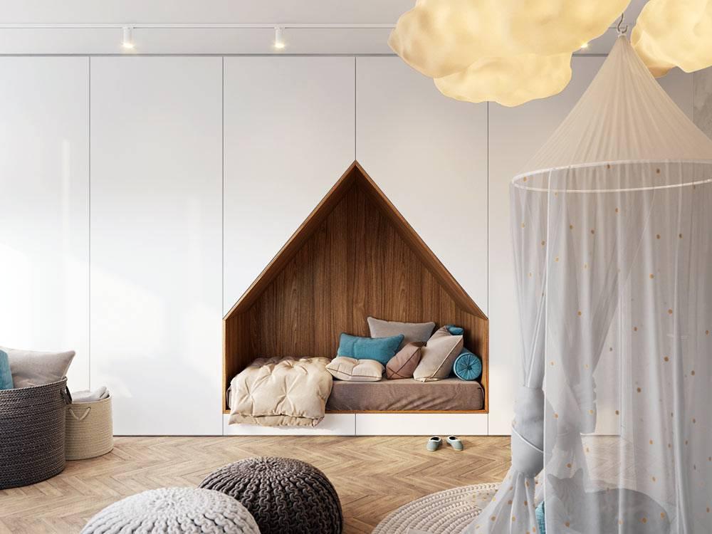 белый шкаф во всю стену детской комнаты с нишей для кровати