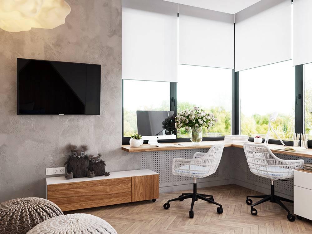 угловой рабочий стол возле окна с красивым видом