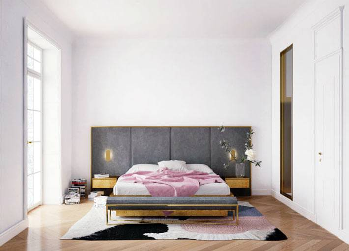 дизайн спальни в стиле лофт с мягкой обивкой на стене за кроватью