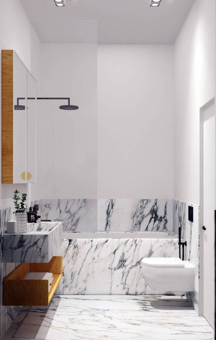 белая ванная с мраморным рисунком на половине стены