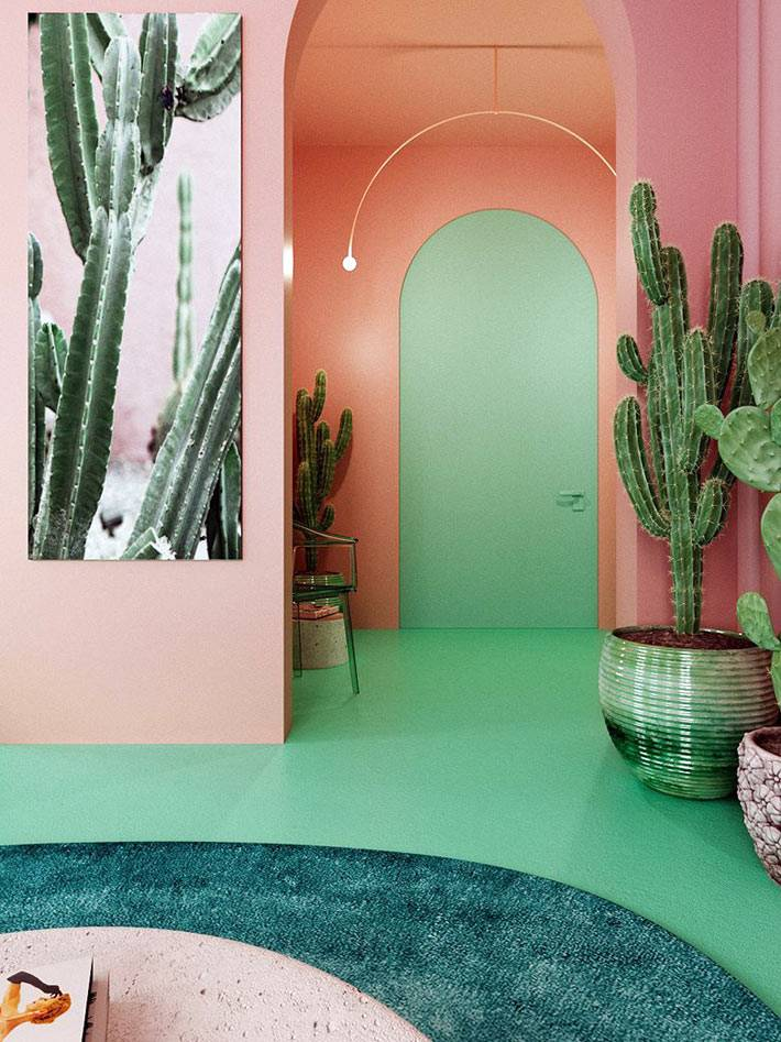 арочная входная дверь зеленого цвета, розовые стены и большие кактусы