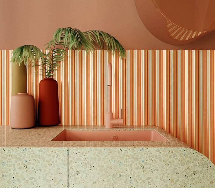 розовый кран и розовая раковина на кухонной мраморной столешнице