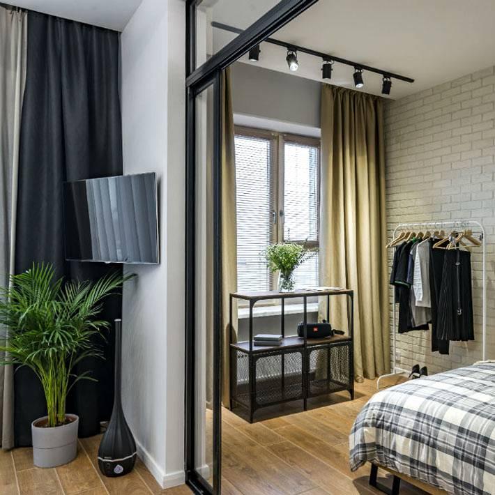 стены в спальне выложены белым кирпичом фото