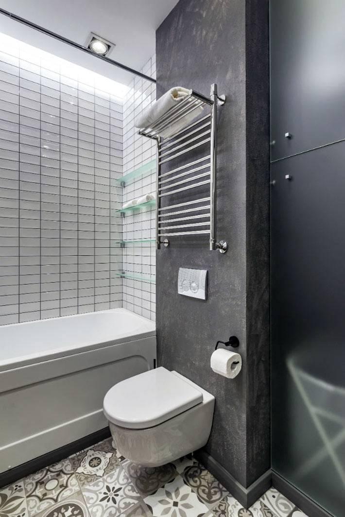 серые цементные стены в современном интерьере ванной