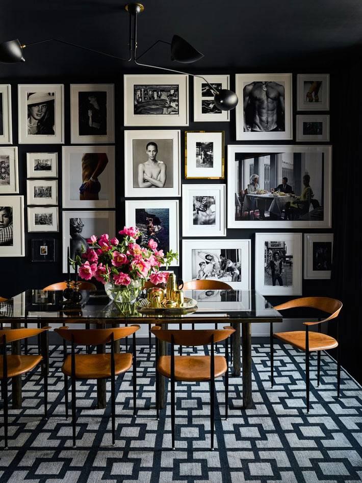 строгий дизайн столовой комнаты в чёрном цвете с фотографиями