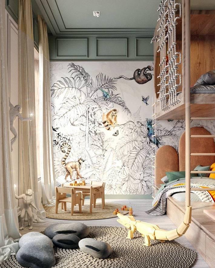 детская комната с разрисованными обоями и игровой зоной